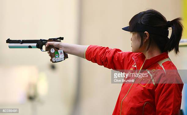 Guo Wenjun of China competes in the women's 10m air pistol final shooting event held at the Beijing Shooting Range Hall during Day 2 of the 2008...