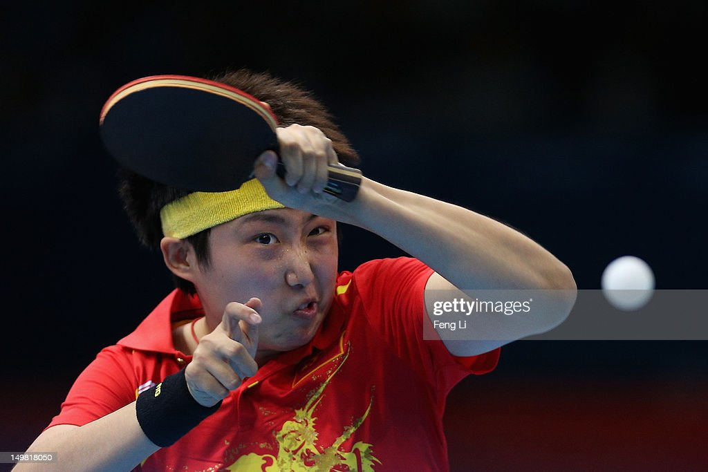 <a gi-track='captionPersonalityLinkClicked' href=/galleries/search?phrase=Guo+Yue&family=editorial&specificpeople=2267823 ng-click='$event.stopPropagation()'>Guo Yue</a> of China competes during Women's Team Table Tennis quarter-final match against team of Netherlands on Day 8 of the London 2012 Olympic Games at ExCeL on August 4, 2012 in London, England.