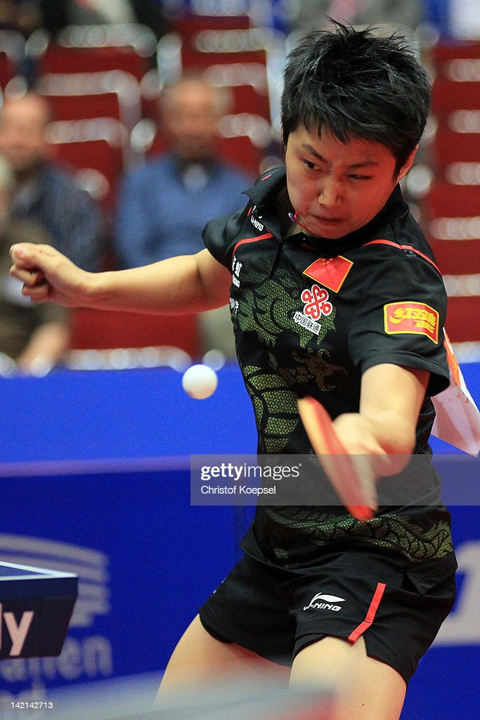 <a gi-track='captionPersonalityLinkClicked' href=/galleries/search?phrase=Guo+Yue+-+Table+Tennis+Player&family=editorial&specificpeople=2267823 ng-click='$event.stopPropagation()'>Guo Yue</a> of China plays a forehand during her match against Li Qian of Poland during the LIEBHERR table tennis team world cup 2012 championship division women's quarter final match betwee China and Poland at Westfalenhalle Dortmund on March 30, 2012 in Dortmund, Germany. China won 3-0 against Poland.
