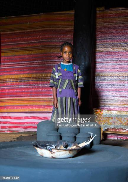 Gurage girl inside her traditional house in front of the fireplace Gurage Zone Butajira Ethiopia on June 18 2017 in Butajira Ethiopia