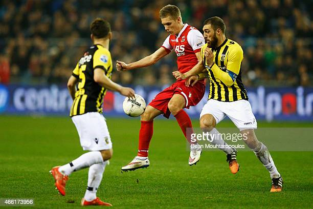 Guram Kashia of Vitesse and Aron Johannsson of AZ battle for the ball during the Dutch Eredivisie match between Vitesse Arnhem and AZ Alkmaar held at...