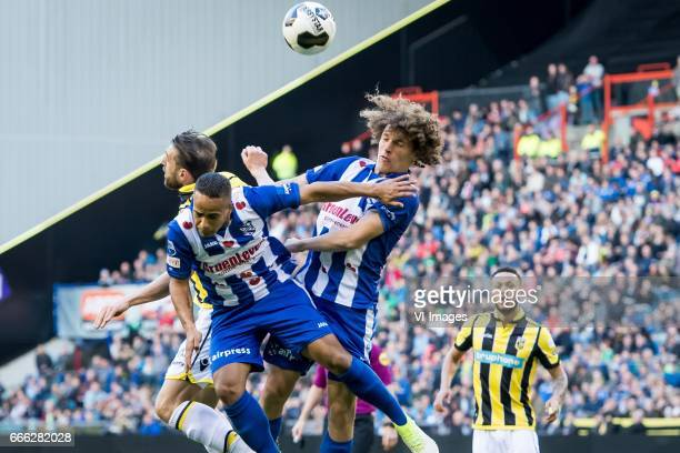 Guram Kashia of Vitesse Jerry Jeremiah St Juste of sc Heerenveen Wout Faes of sc Heerenveen Lewis Baker of Vitesseduring the Dutch Eredivisie match...