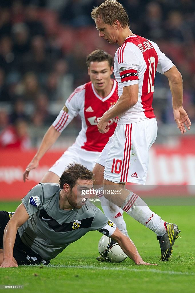 Guram Kashia of Vitesse, Siem de Jong of Ajax, Derk Boerrigter of Ajax during the Dutch Eredivisie match between Ajax Amsterdam and Vitesse Arnhem at the Amsterdam Arena on November 3, 2012 in Amsterdam, The Netherlands.