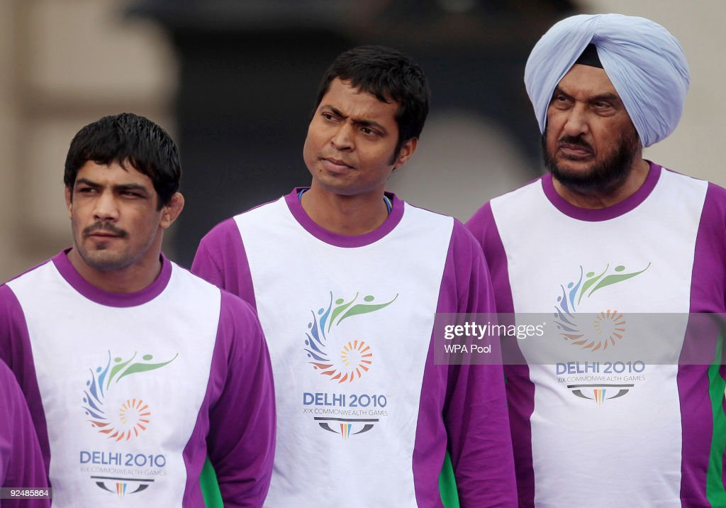Gurbachan Singh Randhawa, (R) Indian Olympian decathlete, Dilip Tirkey, (C) Indian hockey player, and <a gi-track='captionPersonalityLinkClicked' href=/galleries/search?phrase=Sushil+Kumar&family=editorial&specificpeople=703954 ng-click='$event.stopPropagation()'>Sushil Kumar</a>, (L) Indian Olympic bronze medallist wrestler attend the launch of the XIX Commonwealth Games Queen's Baton Relay for the Delhi 2010 Commonwealth Games, outside Buckingham Palace October 29, 2009 in London. The Indian President, Prathibha Devi Singh Patil, and her husband, Dr Devisingh Ramsingh Shekhawat, are concluding their three-day state visit to the UK during which they have stayed in Windsor Castle.