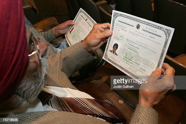 Gurdarshan Gill of India holds his US citizenship certificate during a naturalization ceremony May 22 2007 in San Francisco California Over 1400...