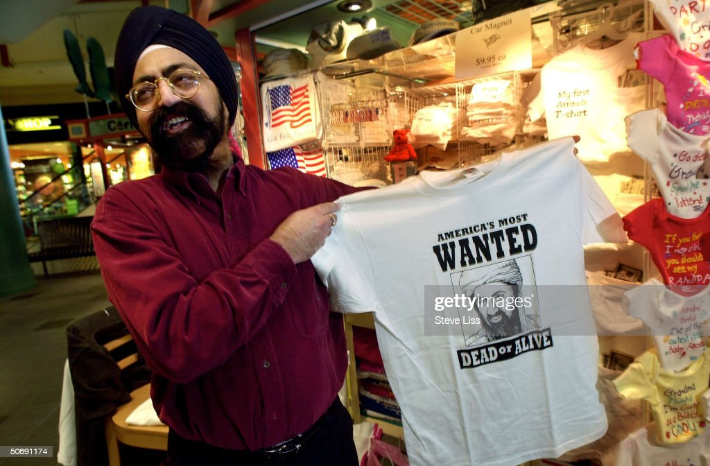 Gurdial Singh displaying a WANTED DEAD OR ALIVE t-shirt picturing alleged September 11 terrorist mastermind Osama Bin Laden at his Varies-Tees booth at the Mall of America.
