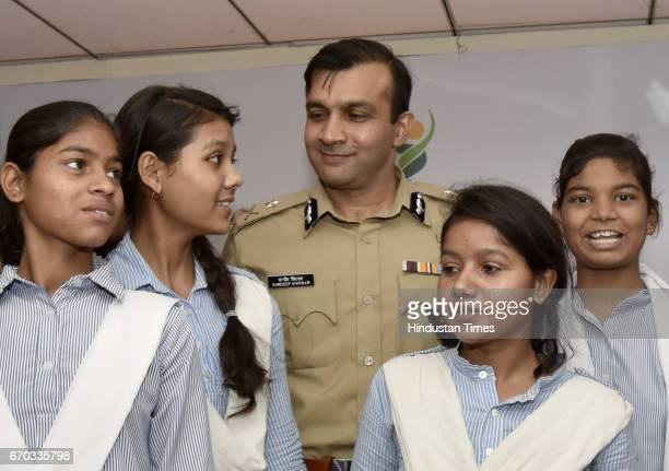 Gurgaon Police Commissioner Sandeep Khirwar poses for photograph with students during the tieup with Amway India to provide women security in the...