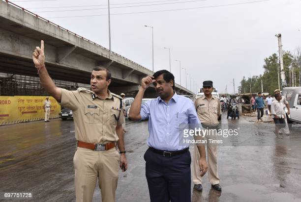 Gurgaon Police Commissioner Sandeep KKhirwar manages traffic with other official at Hero Honda Chowk after the heavy rainfall lashed Delhi and NCR on...