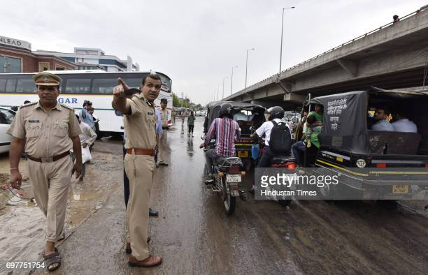 Gurgaon Police Commissioner Sandeep KKhirwar manages traffic with other officials at Hero Honda Chowk after the heavy rainfall lashed Delhi and NCR...