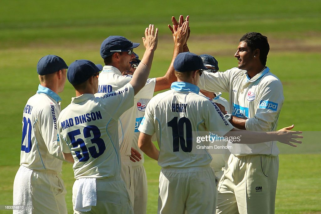Gurinder Sandhu (R) and Trent Copeland of the Blues high five after David Hussey of the Bushrangers was caught out by Copeland from the bowling of Sandhu during day three of the Sheffield Shield match between the Victorian Bushrangers and the New South Wales Blues at Melbourne Cricket Ground on March 9, 2013 in Melbourne, Australia.
