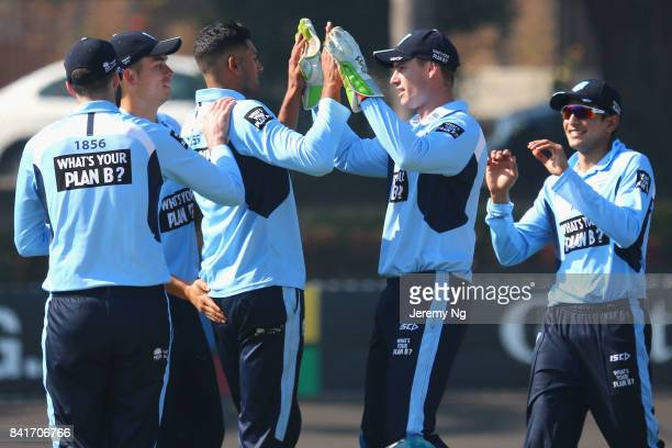 Gurinder Sandhu of Cricket NSW celebrates a wicket with Jay Lenton and Chris Green during the Cricket NSW Intra Squad Match at Hurstville Oval on...