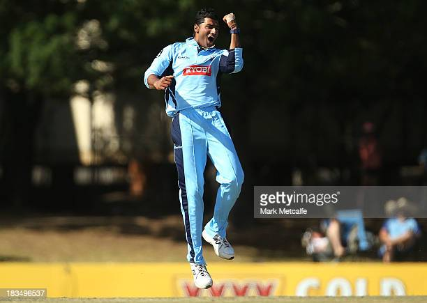 Gurinder Sandhu of the Blues celebrates taking the wicket of David Hussey of the Bushrangers during the Ryobi Cup match between NSW Blues and...