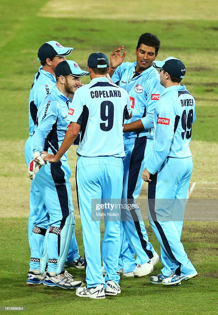 Gurinder Sandhu of the Blues celebrates the wicket of Alex Ross of the Redbacks with team mates during the Ryobi Cup One Day match between the New South Wales Blues and the South Australian Redbacks at Sydney Cricket Ground on February 14, 2013 in Sydney, Australia.
