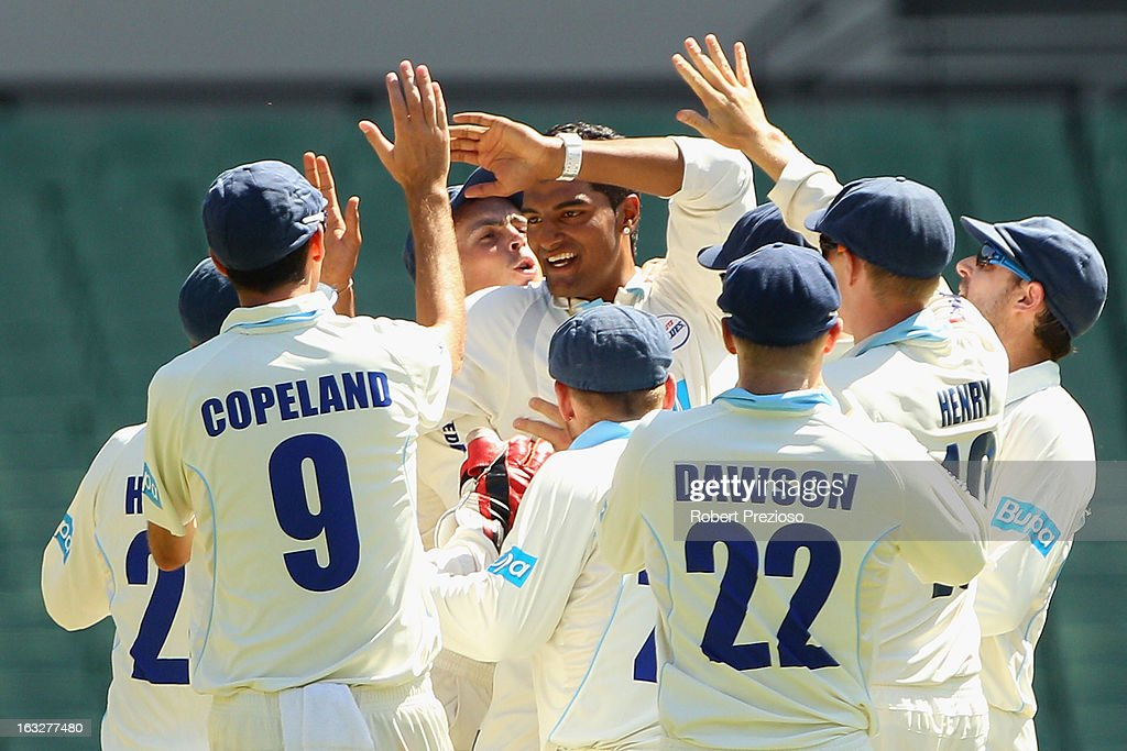 Gurinder Sandhu of the Blues celebrates the wicket of Cameron White of the Bushrangers during day one of the Sheffield Shield match between the Victorian Bushrangers and the New South Wales Blues at Melbourne Cricket Ground on March 7, 2013 in Melbourne, Australia.