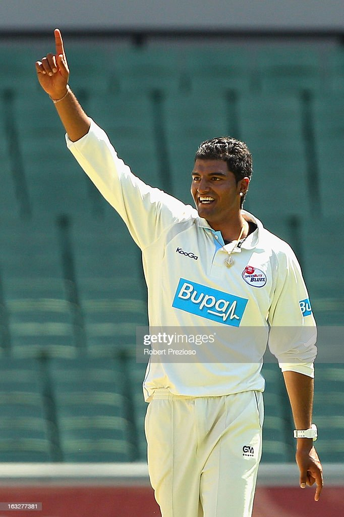 Gurinder Sandhu of the Blues celebrates the wicket of John Hastings of the Bushrangers during day one of the Sheffield Shield match between the Victorian Bushrangers and the New South Wales Blues at Melbourne Cricket Ground on March 7, 2013 in Melbourne, Australia.