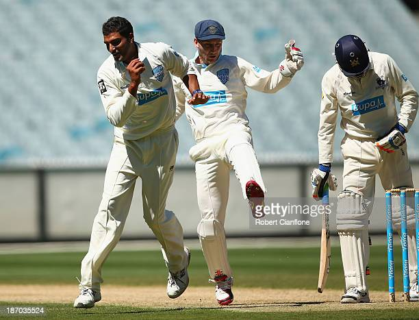Gurinder Sandhu of the Blues collides with wicketkeeper Peter Nevill after taking the catch to dismiss Peter Handscomb of the Bushrangers during the...