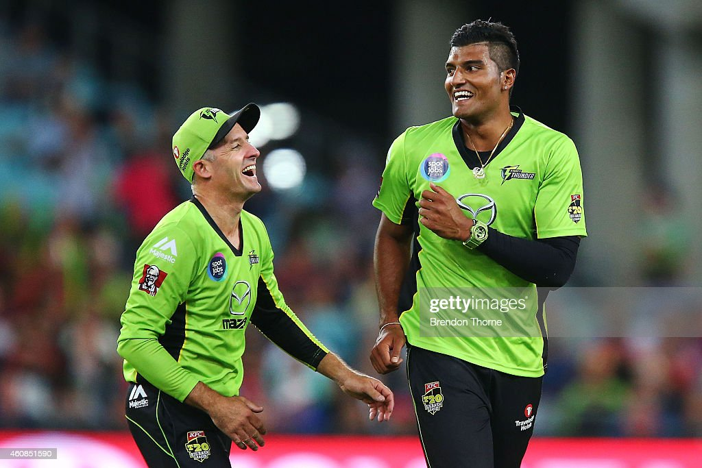 Gurinder Sandhu of the Thunder celebrates with team mate Mike Hussey after claiming the wicket of Jordan Silk of the Sixers during the Big Bash League match between the Sydney Thunder and the Sydney Sixers at ANZ Stadium on December 27, 2014 in Sydney, Australia.