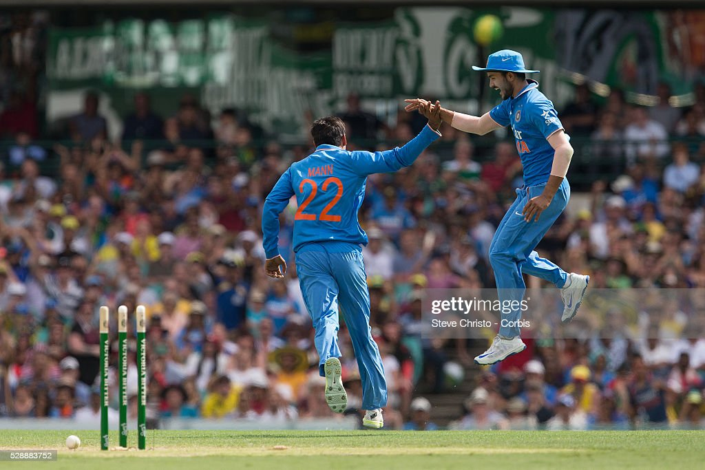 Gurkeerat Singh Mann of India celebrates the runout wicket of Australia's Shaun Marsh with Manish Pandey during the One Day International between...