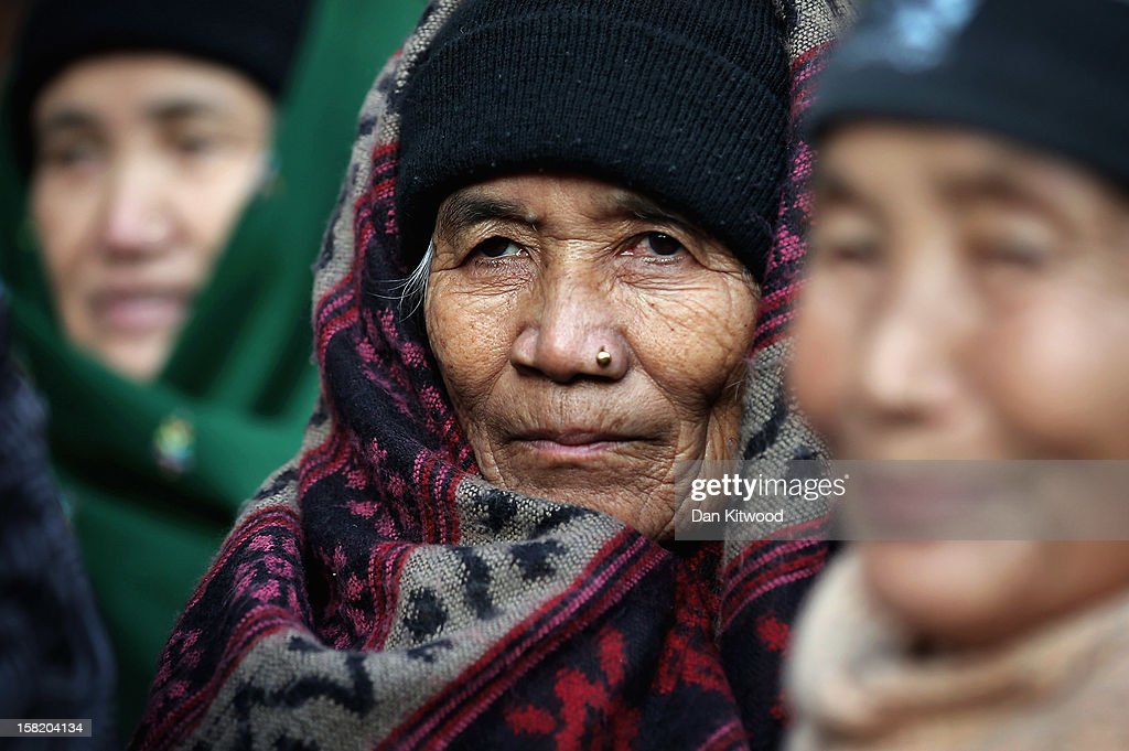 Gurkha woman gather outside the High Court on December 11, 2012 in London, England. Members of the Gurkha community in the UK are continuing their fight for their children to settle in Britain despite losing a test-case at the high court in June 2012, when four adult children of Nepalese fighters were refused the right to settle in the UK.