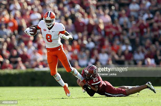 J Gurley of the South Carolina Gamecocks tries to tackle Deon Cain of the Clemson Tigers during their game at WilliamsBrice Stadium on November 28...