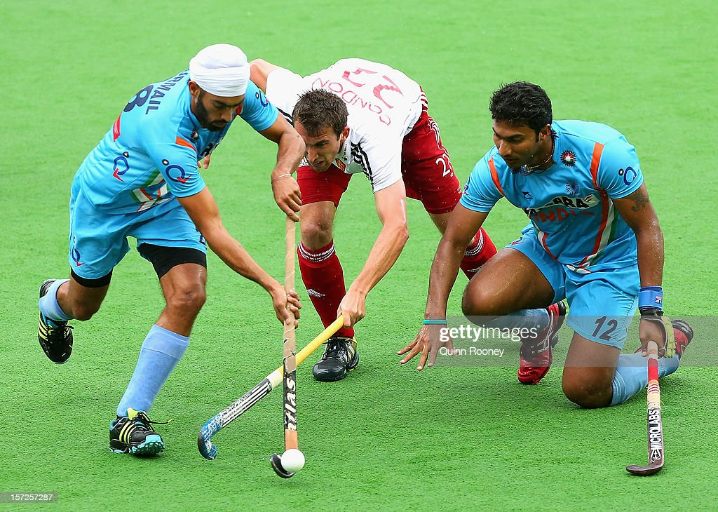 Gurmail Singh of India and David Condon of England contest for the ball during the match between England and India on day one of the Champions Trophy on December 1, 2012 in Melbourne, Australia.