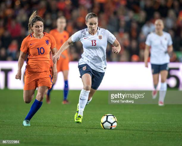 Guro Reiten of Norway Danielle van de Donk of Netherland during the FIFA 2018 World Cup Qualifier between Netherland and Norway at Noordlease Stadion...