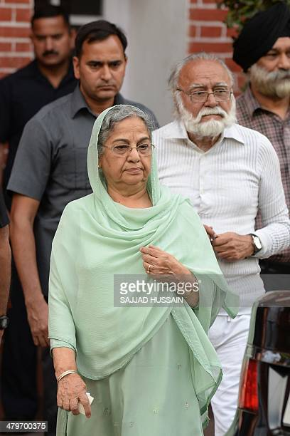 Gursharan Kaur the wife of Indian Prime Minister Manmohan Singh departs after paying tribute to late writer and journalist Khushwant Singh at the...