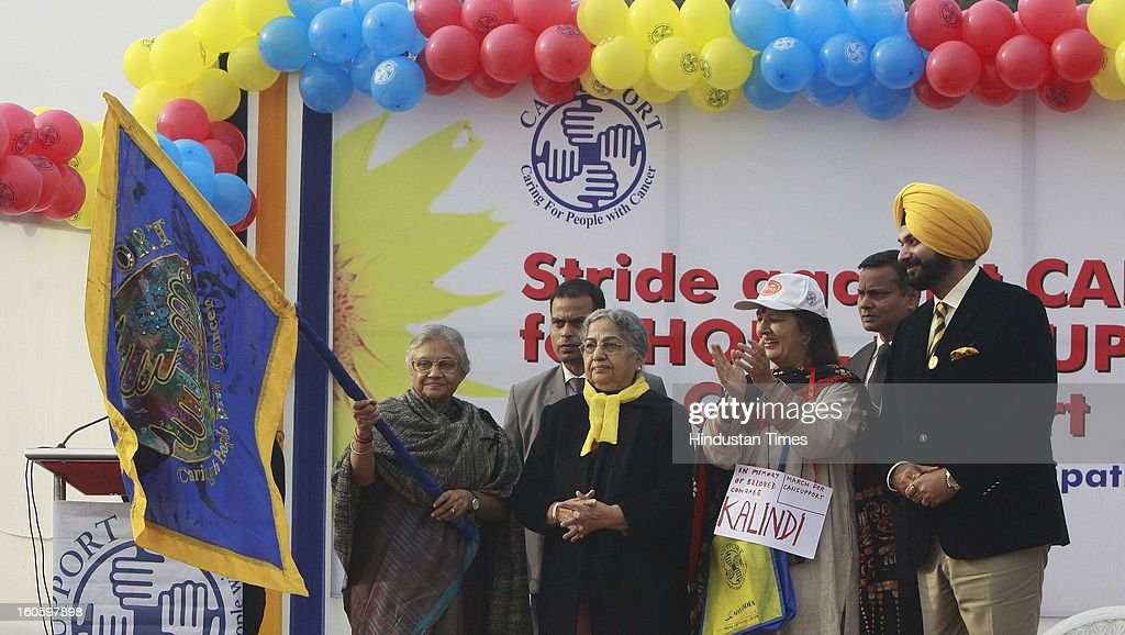 Gursharan kaur Wife of Prime Minister Manmohan Singh, Delhi chief Minister Sheila Dikshit with CPI- M Polit Bureau member Brinda Karat, BJP MP Navjot Singh Sidhu and others flagged off the walk for life for support of Cancer at Rajpath on February 3, 2013 in New Delhi, India. A Colorful event that saw school children prominent citizens and peoples from all Sections of Society gather to express their solidarity with hose living with cancer and to mark world cancer day.