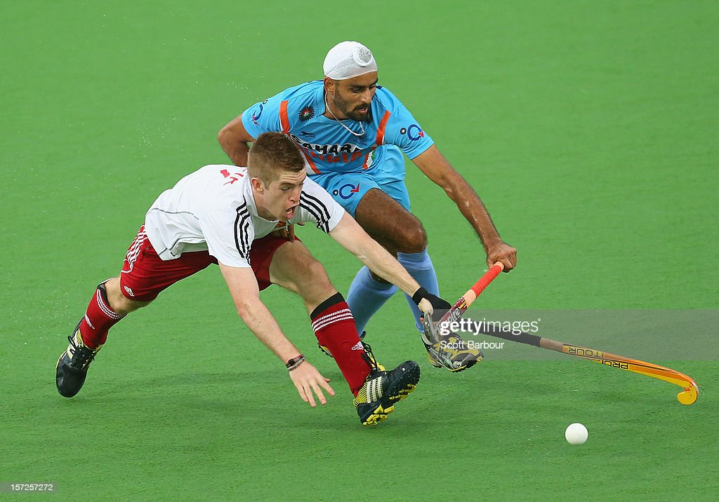 Gurvinder Singh Chandi of India and Henry Weir of England compete for the ball during the match between England and India on day one of the Champions Trophy on December 1, 2012 in Melbourne, Australia.