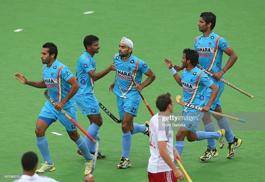 Gurvinder Singh Chandi of India is congratulated by his team mates after scoring a goal during the match between England and India on day one of the Champions Trophy on December 1, 2012 in Melbourne, Australia.