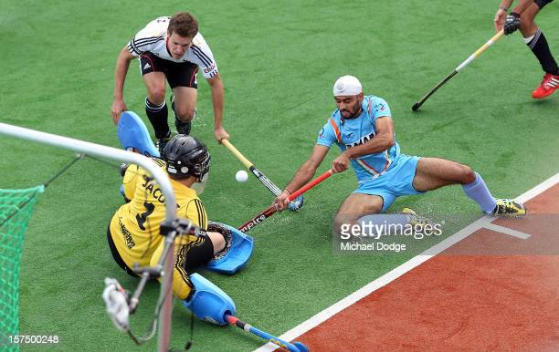 Gurwinder Singh Chandi of India has his goal attempt stopped by goal keeper Nicholas Jacobi of Germany during the match between India and Germany...