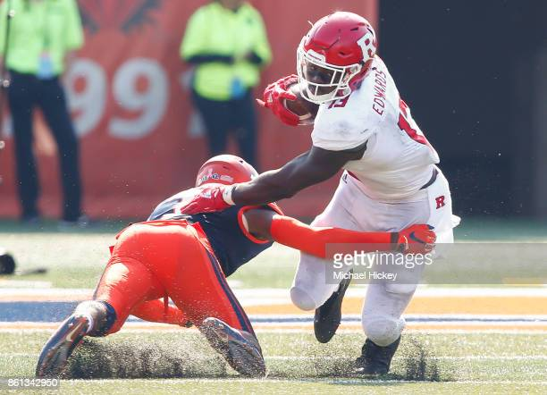 Gus Edwards of the Rutgers Scarlet Knights runs the ball as Stanley Green of the Illinois Fighting Illini misses the tackle at Memorial Stadium on...