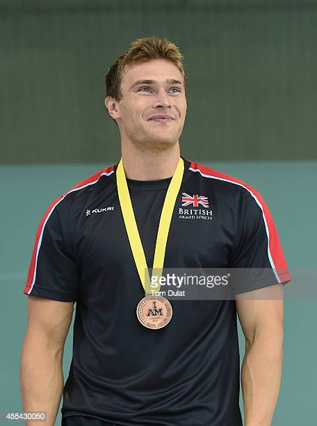 Gus Hurst of Great Britain poses with his Bronze Medal after the Men's S10 50m Backstroke on Day Four of Invictus Games at Olympic Park on September...