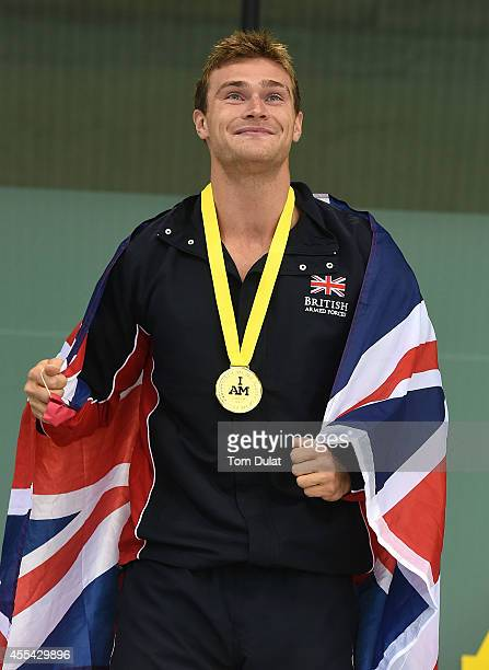 Gus Hurst of Great britain poses with his Gold Medal after the Men's S10 50m Freestyle on Day Four of Invictus Games at Olympic Park on September 14...