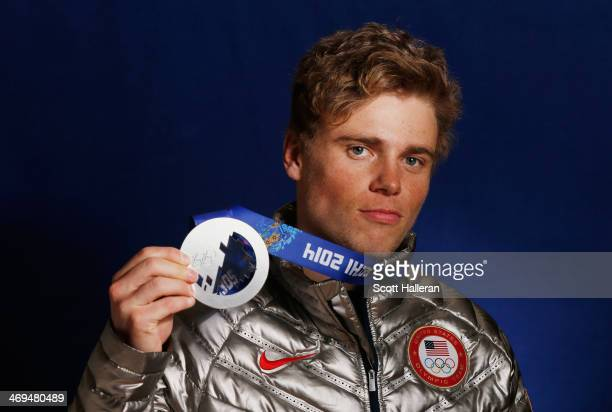 Gus Kenworthy of the USA Skiing team poses with his silver medal in the Olympic Park during the Sochi 2014 Winter Olympics on February 14 2014 in...
