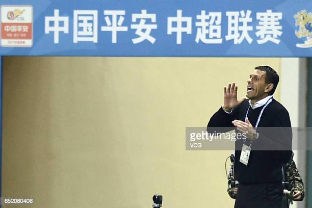 Gus Poyet head coach of Shanghai Shenhua speaks to his players during the 2nd round match of CSL Chinese Football Association between Shanghai...