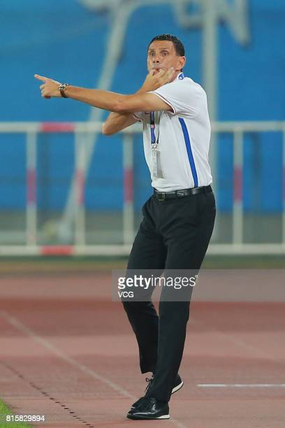 Gus Poyet head coach of Shanghai Shenhua speaks to his players during the 17th round match of 2017 Chinese Football Association Super League between...