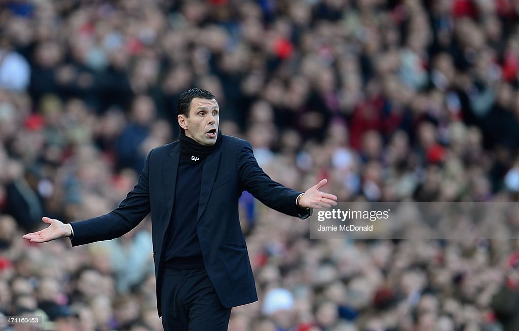 Gus Poyet of Sunderland looks on during the Barclays Premier League match between Arsenal and Sunderland at Emirates Stadium on February 22, 2014 in London, England.