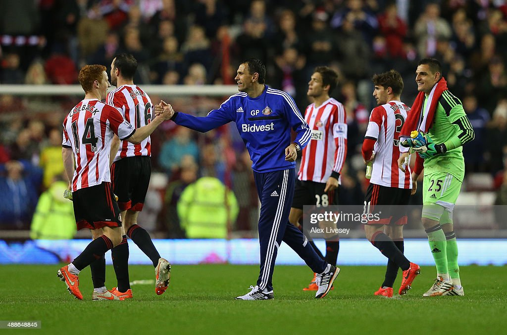 Gus Poyet the manager of Sunderland celebrates with <a gi-track='captionPersonalityLinkClicked' href=/galleries/search?phrase=Jack+Colback&family=editorial&specificpeople=4940395 ng-click='$event.stopPropagation()'>Jack Colback</a> and his players after the Barclays Premier League match between Sunderland and West Bromwich Albion at the Stadium of Light on May 7, 2014 in Sunderland, England.