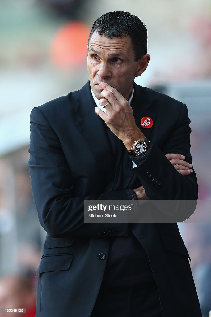 Gus Poyet the manager of Sunderland looks on from the dugout during the Barclays Premier League match between Swansea City and Sunderland at the Liberty Stadium on October 19, 2013 in Swansea, Wales.