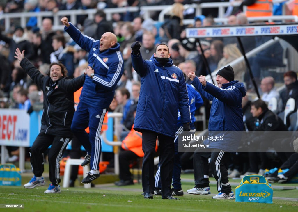 Gus Poyet the Sunderland manager and his coaching staff celebrate their team's third goal during the Barclays Premier League match between Newcastle United and Sunderland at St James' Park on February 1, 2014 in Newcastle upon Tyne, England.