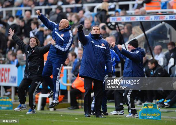 Gus Poyet the Sunderland manager and his coaching staff celebrate their team's third goal during the Barclays Premier League match between Newcastle...