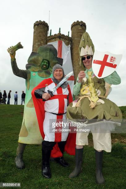 Gus the Asparagus Man St George and the Asparafairy celebrate the start of the asparagus season at Broadway Tower Worcestershire