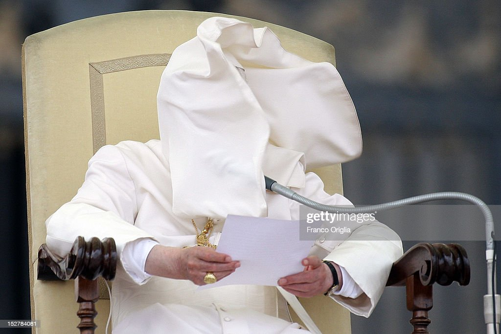 A gust of wind blows Pope Benedict XVI's cloak into his face as he attends his weekly audience in St. Peter's Square on September 26, 2012 in Vatican City, Vatican. The opening of the trial of pope's former butler Paolo Gabriele, accused of passing private documents from Benedict XVI to journalists, will start next saturday September 29.