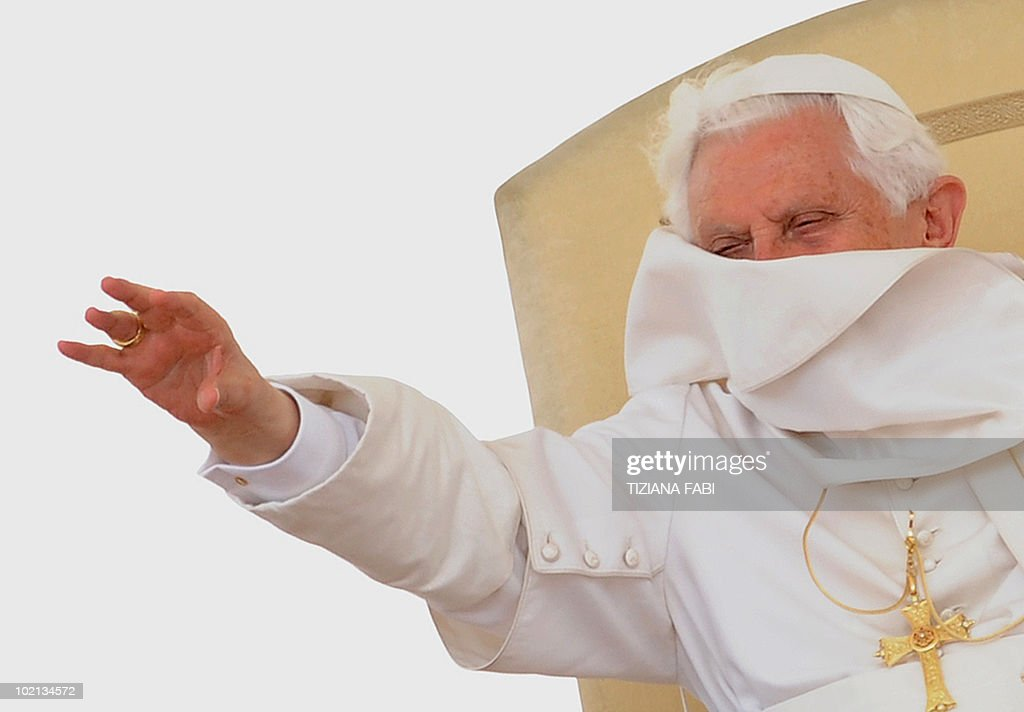 A gust of wind catches the robe of Pope Benedict XVI during his weekly general audience in Saint Peter's Square at the Vatican on June 16, 2010 .