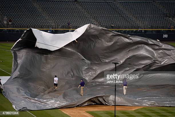 A gust of wind just about takes out the tarp as Colorado Rockies ground crew scrambles to get the tarp unrolled and cover the infield as a rain storm...