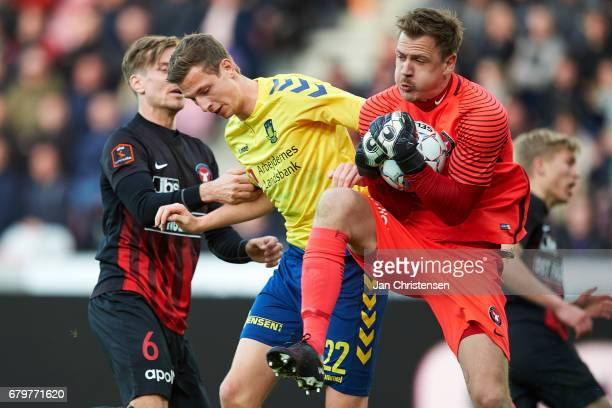 Gustaf Nilsson of Brondby IF and Goalkeeper Johan Dahlin of FC Midtjylland compete for the ball during the Danish Cup DBU Pokalen semifinal match...