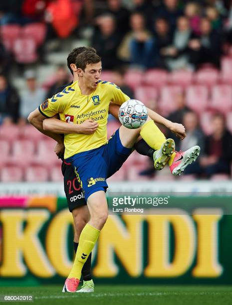 Gustaf Nilsson of Brondby IF and Rasmus Nicolaisen of FC Midtjylland compete for the ball during the Danish Alka Superliga match between FC...