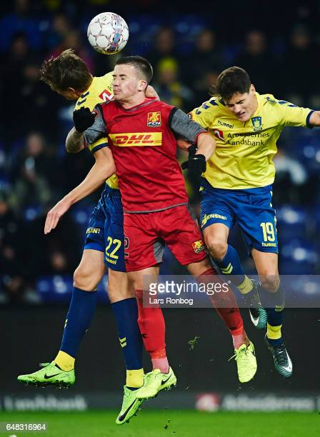 Gustaf Nilsson of Brondby IF Karlo Bartolec of FC Nordsjalland and Christian Norgaard of Brondby IF compete for the ball during the Danish Alka...