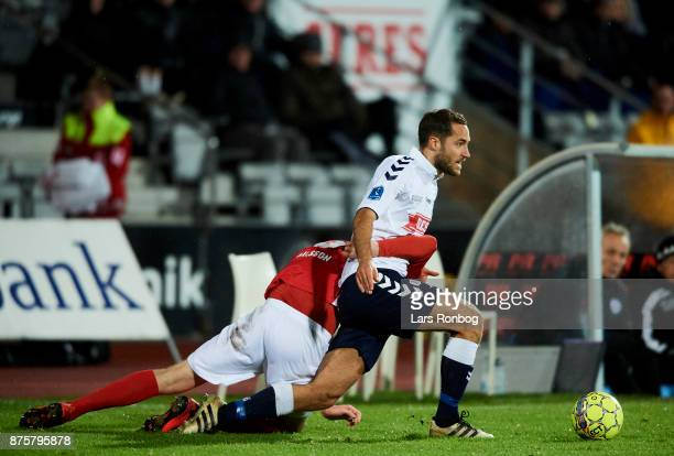 Gustaf Nilsson of Silkeborg IF and Niklas Backman of AGF Aarhus compete for the ball during the Danish Alka Superliga match between AGF Aarhus and...
